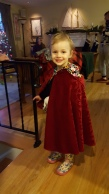 Eleanor in the cape she got from Mrs. Claus