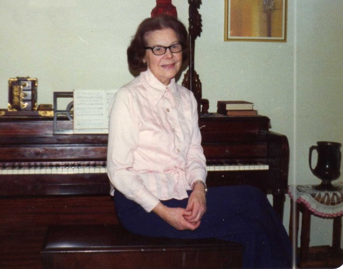 Gran sitting on piano bench March 1975 185